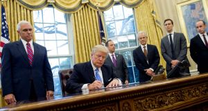 "President Donald Trump signs one of three executive orders in the Oval Office of the White House on Monday, inluding reinstating the abortion ""gag rule"".  Photograph:  Saul Loeb/AFP/Getty Images"