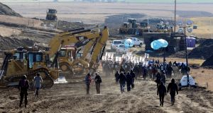 : Protesters march along the pipeline route during a protest against the Dakota Access pipeline in November. Photograph: Stephanie Keith/Reuters