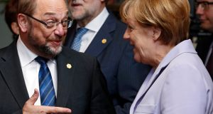 Martin Schulz  with  Angela Merkel:  The former European Parliament president has been proposed to replace Sigmar Gabriel as head of the SPD, best able to challenge  the chancellor in Germany's September  elections. Photograph: EPA/Julien Warnand