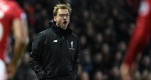 Jürgen Klopp accepts there is no point in talking of fighting for the title while it is still Chelsea's to lose. Photograph: Oli Scarff/AFP/Getty Images