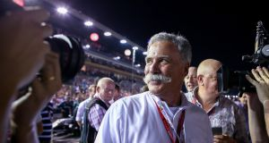 Chase Carey, F1 chairman, walks on the track before the start of the Singapore Formula One Grand Prix. Photo: Diego Azubel/EPA