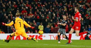 Southampton's Shane Long scores in injury time in the EFL Cup second leg against Liverpool at Anfield. Photograph: Jason Cairnduff/Action Images via Reuters/Livepic