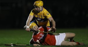 Clare's Cian Dillon and Michael O'Halloran of Cork in action in the Munster Senior Hurling League match at  Sixmilebridge. Photograph:  Lorraine O'Sullivan/Inpho