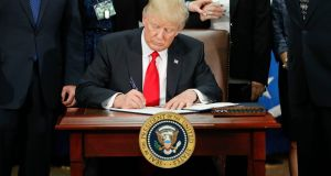 Donald Trump signs an executive order for border security and immigration enforcement improvements on Wednesday. Photograph: Pablo Martinez Monsivais/AP