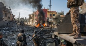 Iraqi special pperations soldiers survey the aftermath of a suicide car bomb that managed to reach their lines in the Al Andalus neighborhood of eastern Mosul. Photograph: Ivor Prickett/New York Times