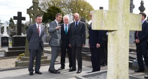 Britain's Prince Edward,  Duke of Kent, isshown the grave of Eamon de Valera during a visit to Glasnevin cemetery in May 2013. Photograph: Alan Betson