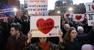 Hundreds of people attend an evening rally at Washington Square Park in New York in support of Muslims, immigrants and against the building of a wall along the Mexican border. Photograph: Spencer Platt/Getty Images