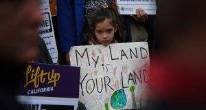 "Maya Casillas (7) takes part in a  protest outside  City Hall in Los Angeles against US president Donald Trump's crackdown on ""sanctuary cities"",  which generally do not comply with federal requests to detain unauthorised immigrants who have been arrested on charges unrelated to their immigration status. Photograph: Mark Ralston/AFP/Getty Images"