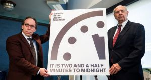 "Theoretical physicist Lawrence Krauss and retired ambassador  Thomas Pickering announce the Bulletin of Atomic Scientists' decision to move the Doomsday Clock closer to  midnight. The group, founded by scientists who worked on the Manhattan Project,  designed the clock to ""convey how close we are to destroying civilization"". Photograph: EPA/Jim Lo Scalzo"