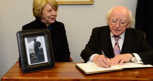 President Michael D Higgins signs a book of condolence for former Cuban Leader Fidel Castro at the Cuban Embassy in Dublin last November with his wife Sabina. Photograph: Dara Mac Dónaill