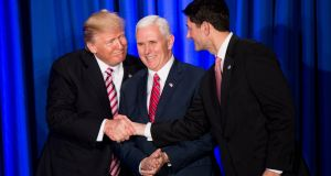 US president Donald Trump with vice president Mike Pence  and  speaker of the house Paul Ryan at a  Republican retreat   in Philadelphia, Pennsylvania. Photograph:  Bill Clark-Pool/Getty Images
