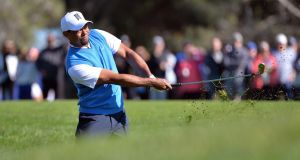 Tiger Woods hit from the rough at Torrey Pines.