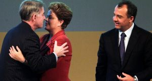 Eike Batista greets then president Dilma Rousseff in 2012, while Sergio Cabral, then governor of Rio de Janeiro, looks on. Mr Cabral is now in prison, facing corruption charges. Photograph: Ricardo Moraes/Reuters