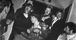 Survivors of the Stardust disaster being rescued by firefighters in 1981. Photograph: Myles Byrne/Irish Press Group