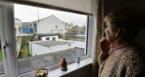 Brenda Kelly in her house from where she saw  flames coming from the roof of the Stardust dance hall in Artane. Photograph: Alan Betson