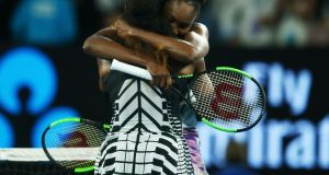 Serena Williams hugs her sister Venus after winning the women's singles final of the Australian Open. Photograph: Getty Images