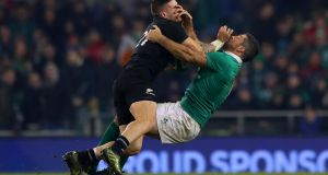 New Zealand's TJ Perenara hits Ireland fullback  Rob Kearney high at the Aviva Stadium in November. Photograph: James Crombie/Inpho