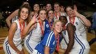Ambassador UCC Glanmire players celebrate  winning the Women's National Cup. Photograph: Gary Carr/Inpho