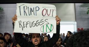 A protest at the arrivals hall of San Francisco's SFO International Airport after people arriving from Muslim-majority countries were held at the border control as a result of the new executive order. Photograph: Peter Dasilva/EPA