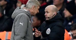 Arsenal manager Arsene Wenger clashes with fourth official Anthony Taylor before being sent to the stands. File photograph: Dylan Martinez/Reuters