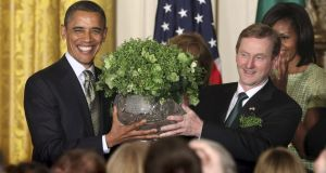 U.S. President Barack Obama receives a bowl of shamrock from Taoiseach Enda Kenny  during a St Patrick's Day reception at the White House in Washington. Photograph: Chris Kleponis/Reuters