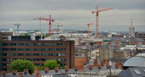 With the economy expected to continue its recovery and a number of significant developments due to enter the construction phase, it is likely the number of cranes on Dublin's skyline will increase. Photograph: Alan Betson