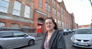 Sarah Kelleher, chair of the Lourdes Community Youth Service, outside  the former Rutland Street school. It appears a promise to refurbish the building is about to be reneged on. Photograph: Alan Betson