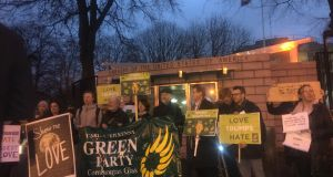 Two dozen members of the Green Party staged a silent protest outside the US embassy in Dublin. Photograph: Ronan McGreevy