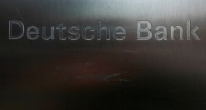 Scratches on the logo of Germany's Deutsche Bank in Frankfurt. Photograph: Reuters