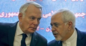French foreign minister Jean-Marc Ayrault  and Iranian foreign minister Mohammad Javad Zarif in Tehran on Tuesday. Photograph: Atta Kenare/AFP/Getty Images