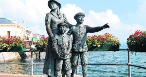 Statue in Cobh, Co Cork, of Annie Moore, the first immigrant to be processed at Ellis Island, and her brothers: she settled in the Lower East Side of New York