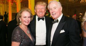 Brian Burns and his wife Eileen with Donald Trump at a ball in Florida. Photograph: Capehart