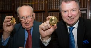 Receiving their  Royal Irish Academy gold medals on Tuesday were  Louis Cullen (left), professor emeritus in history at  Trinity College Dublin, and Fergus Shanahan, professor and chairman of the department of medicine at University College Cork and director of the APC Microbiome Institute. Photograph: Johnny Bambury