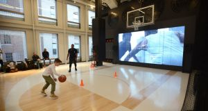 Playing basketball at a  Nike store in New York: Nike was dragged down 1.3 per cent. Photograph: Jennifer S Altman/The New York Times