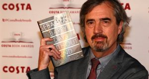 Sebastian Barry with his book Days Without End. Chair of judges Kate Williams described it as 'magnificent, and searing'. Photograph: Peter Nicholls/Reuters
