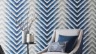Harlequin's new Momentum wallpaper collection is very much inspired by the early 20th century. This iridescent Makalu ombre and chevron pattern makes a strong style statement in a room and works best when paired with plainly upholstered furniture like the taupe linen pictured. It costs €74 per roll from all Harlequin stockists.  (harlequin.co.uk)