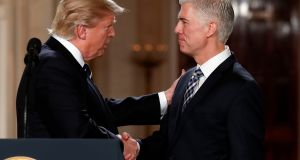 Your Hired: President Donald Trump shakes hands with 10th U.S. Circuit Court of Appeals Judge Neil Gorsuch, his choice for Supreme Court associate justice in the East Room of the White House in Washington, Tuesday, Jan. 31, 2017. (AP Photo/Carolyn Kaster)