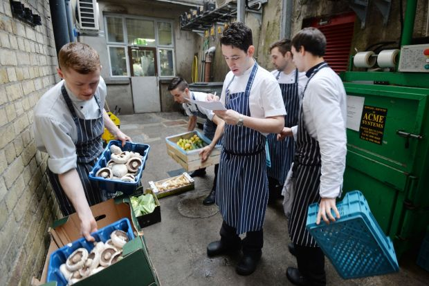 Head Chef Eric Matthews taking in a delivery of vegetables as part of food preparations at Chapter One. 