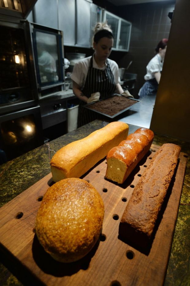 Cassie Deegan, Sous Pastry Chef preparing the bread for the day. 