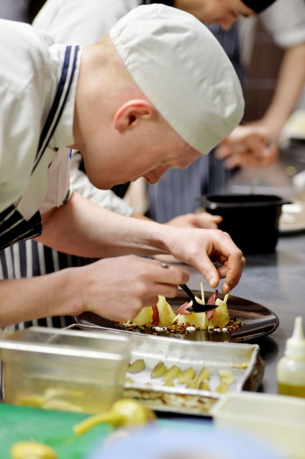 Paddy Walsh Chef de Parti preparing food for clients.