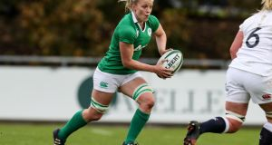 "Ireland's Claire Molloy in action against England at Belfield: ""We have a lot of pride in the green shirt."" Photograph: Billy Stickland/Inpho"