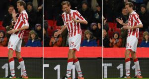 "Stoke City striker Peter Crouch does his ""robot"" celebration after scoring his 100th Premier League goal  in the Premier League game against  Everton at the Bet365 Stadium. Photograph:  Paul Ellis/AFP/Getty Images"