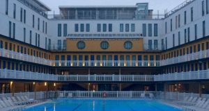 The outdoor swimming pool at the Hotel Molitor is heated to 28 degrees year round