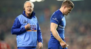 Dr Arthur Tanner  attending to  Brian O'Driscoll at the Aviva Stadium in 2014. Photograph: James Crombie/Inpho
