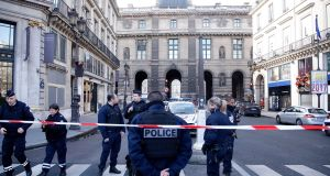 Police officers cordon off the area next to the Louvre museum in Paris. Photograph: Thibault Camus/AP
