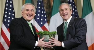 The wearying of the green: Bertie Ahern presents George W Bush  with a bowl of shamrocks on  March 16th, 2007, four years into the Iraq War. Photograph: Reuters/Jim Young