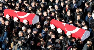Urban targets:  coffins are carried through the  crowd at the  funeral of police officers who were killed in a bomb attack on the  Besiktas football stadium in Istanbul in  December 2016. Photograph: Sedat Suna/EPA