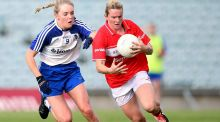 Monaghan's Eimear McAnespie in action against Briege Corkery of Cork in the Ladies Senior All-Ireland Football Championship semi-final. Photograph: Tommy Dickson/Inpho