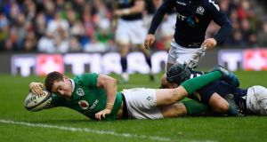 Ireland outhalf Paddy Jackson dives over to score his side's third try. Photograph: Stu Forster/Getty Images