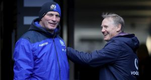 Coaches Vern Cotter and Joe Schmidt share a moment before the Six Nations match at Murrayfield. Photograph: Dan Sheridan/Inpho
